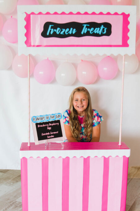 Little girl with frozen treat stand