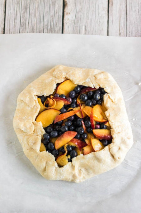 Peach and blueberry galette with dough folded over
