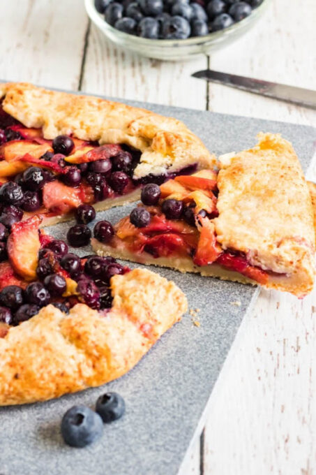 A slice of blueberry and peach galette