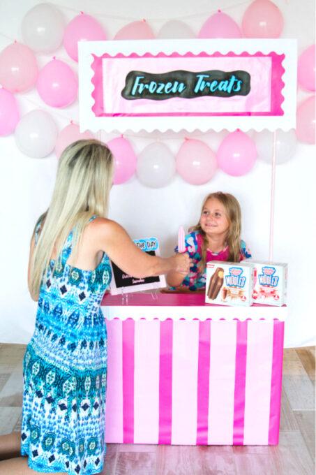Little girl handing out frozen treats