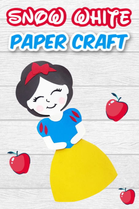 Snow White paper doll on wooden table