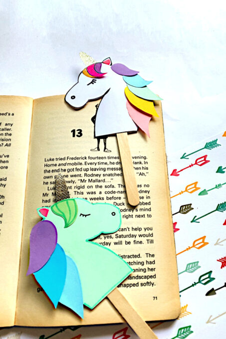 Two unicorn bookmarks on a book