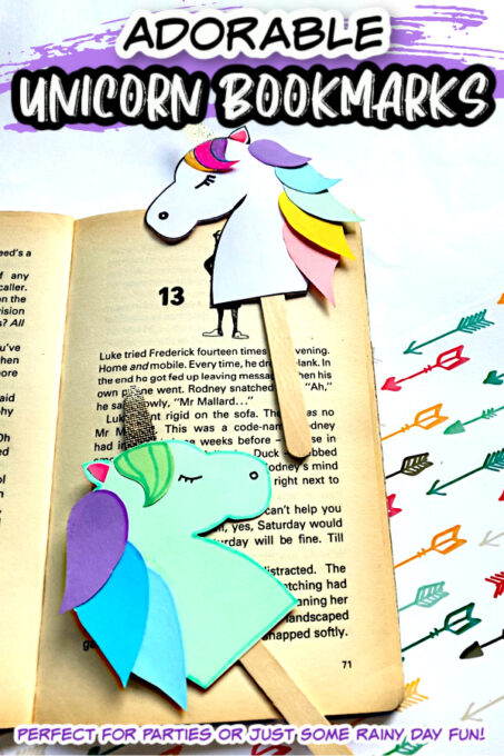 Green and white unicorn bookmarks on book