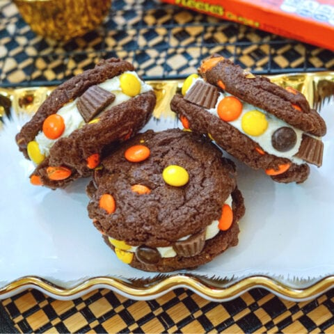 Reeses pieces stuffed chocolate peanut butter cookies on plate