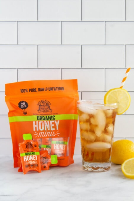 Honey Packets with a glass of iced tea