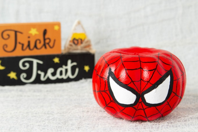 Spiderman pumpkin with trick or treat sign