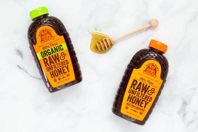 Two-bottles-of-Nature-Nates-Honey