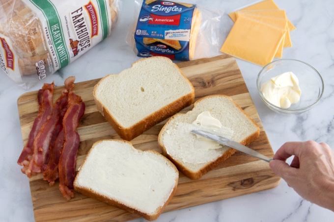 Buttering bread for grilled cheese sandwich