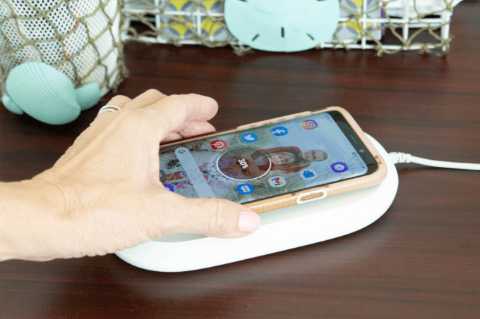 Cell phone on Ixpand Wireless Charger