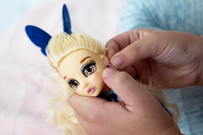Putting earrings on @PreppyPosh doll