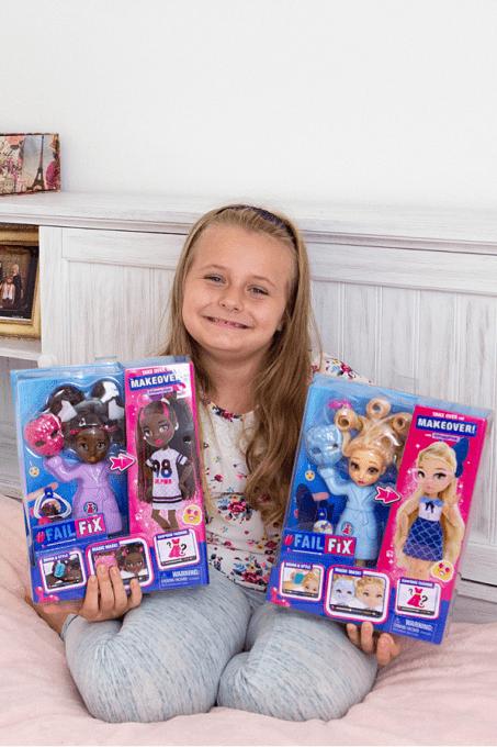 Girl holding FailFix dolls