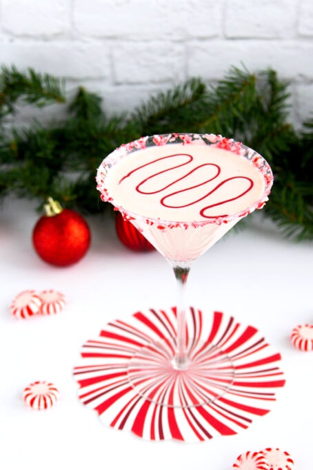 White chocolate peppermint martini with holiday decorations