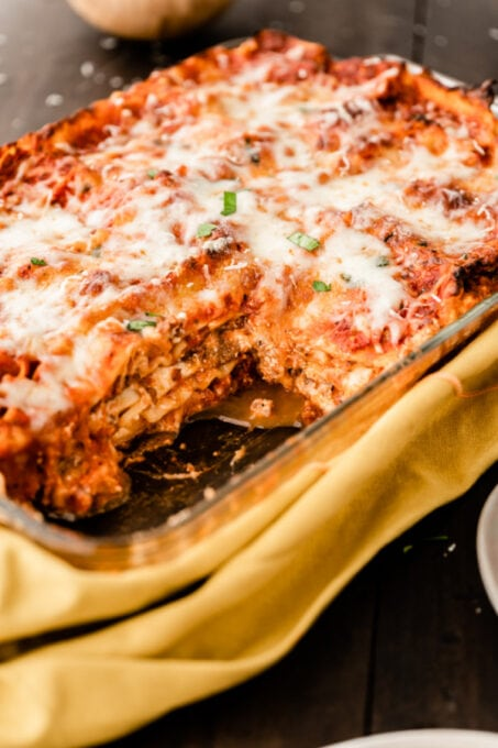 Pan of homemade lasagna with slice removed