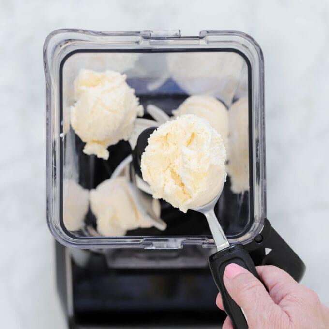 Adding vanilla ice cream to blender