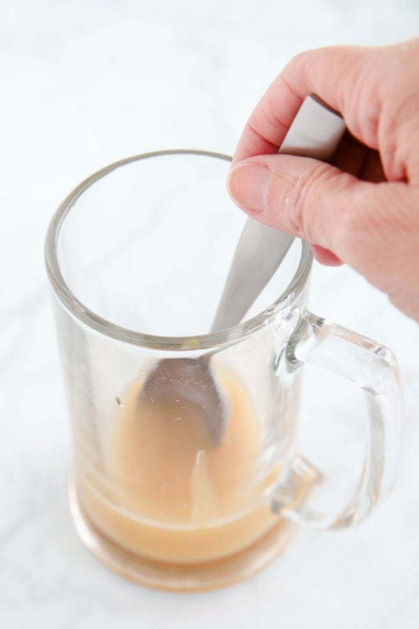 Mixing butterscotch syrup and cream soda