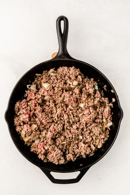 Ground beef with onions in pan
